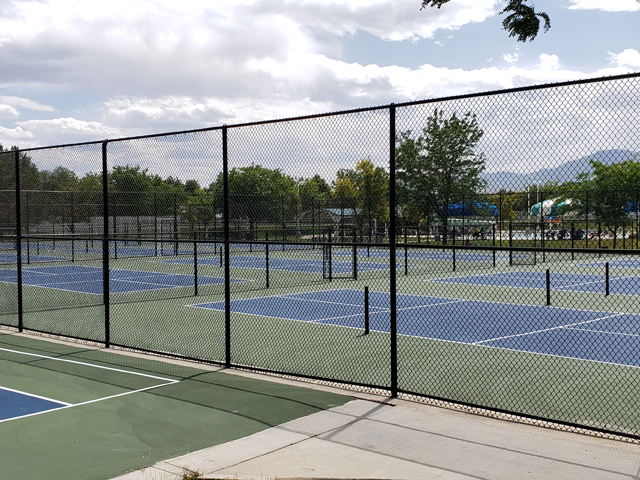 gated tennis court complex