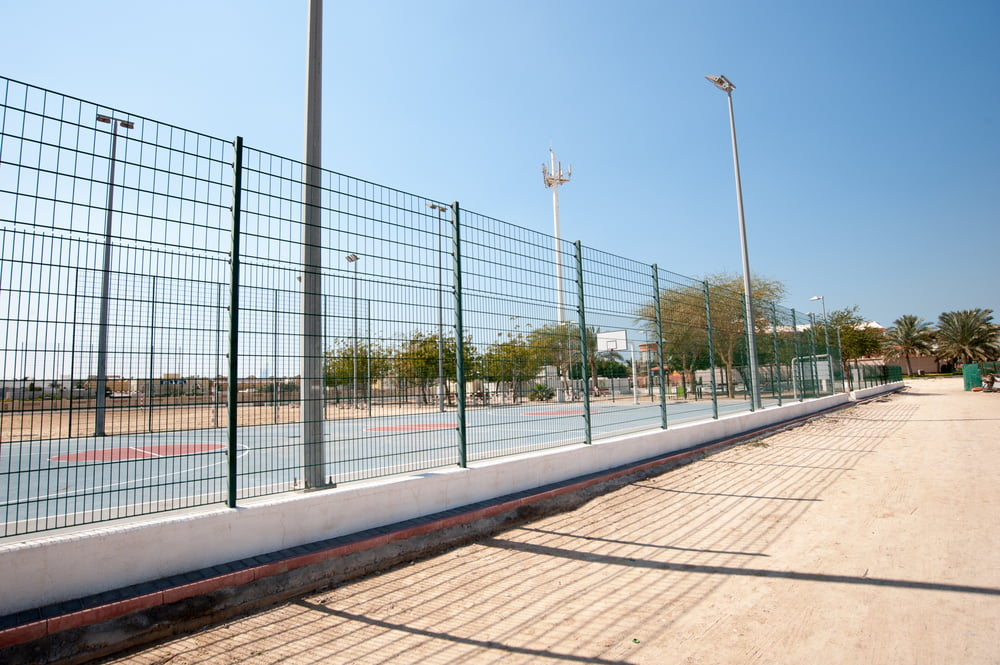 fencing complements tennis basketball courts